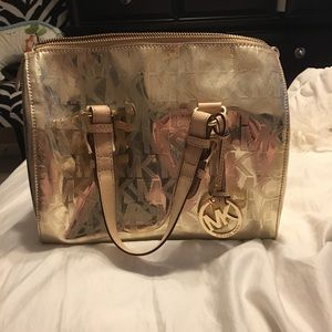 100% authentic gold shinny Michael Kors hand bag